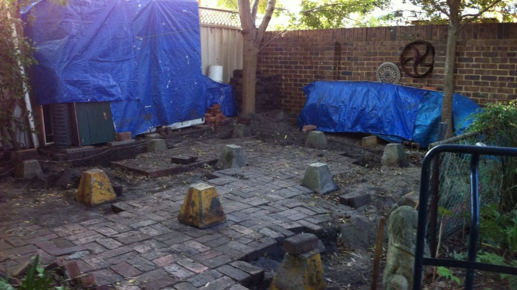The previously unused paved area at the bottom of the couple's garden.