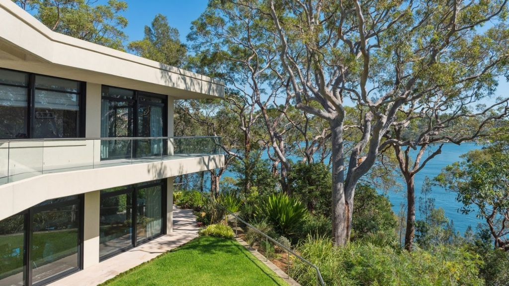 The distinctive residence was built in 1997 and designed by architect Mike Alexander. Photo: Supplied