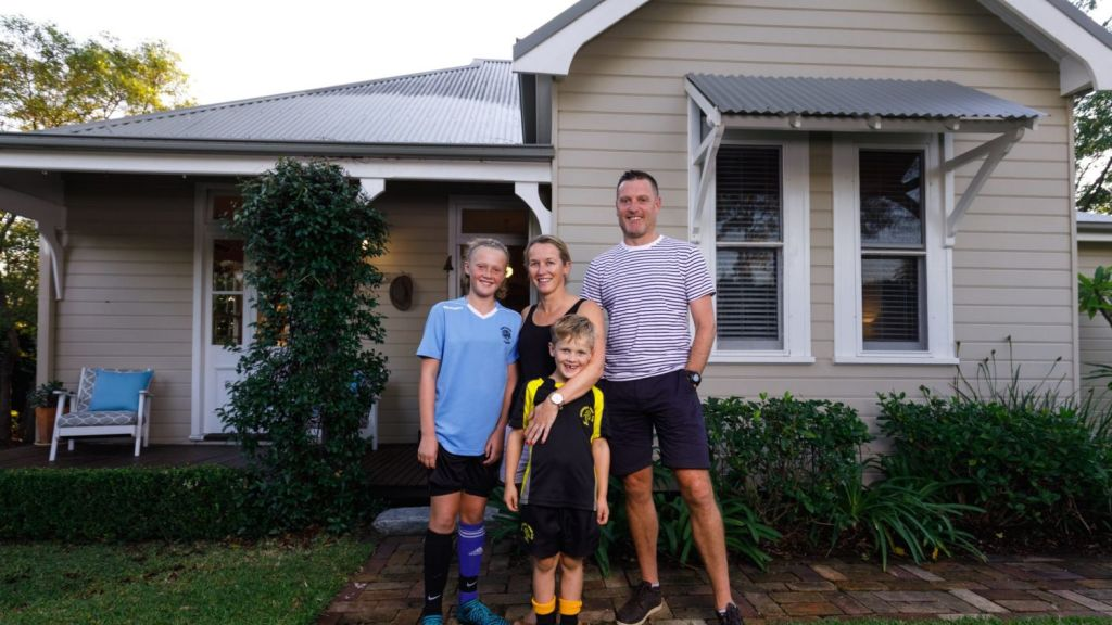 Hornsby homeowners Holly and Alex Peasland, pictured with two of their three children Poppy, 11, and Albie, 6, hope their family home will buck the trend. Photo: Steven Woodburn