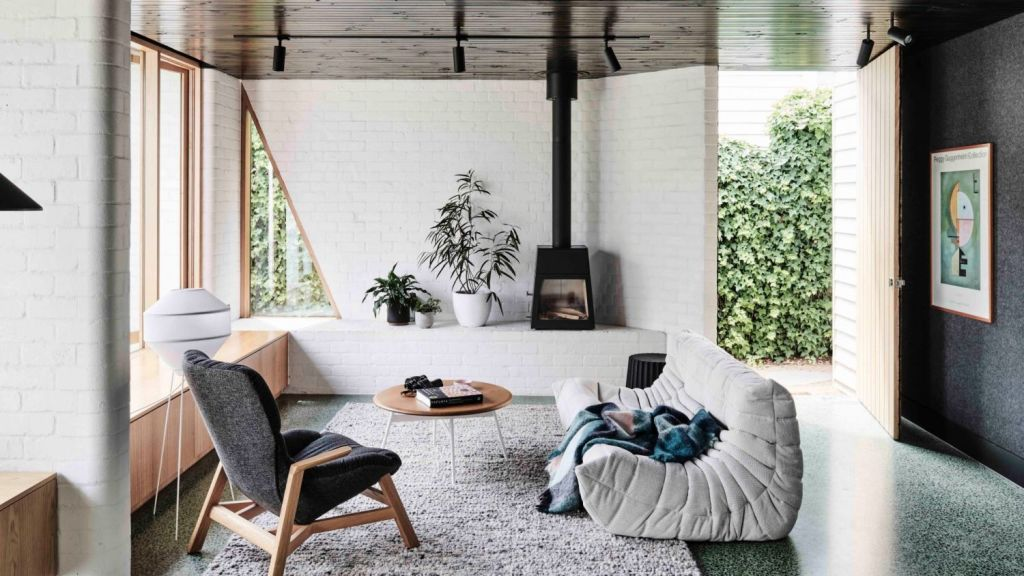 The timber ceiling was kept at a low height and washed with a dark Japanese stain to help draw the eye out towards the garden. Photo: Tom Blachford