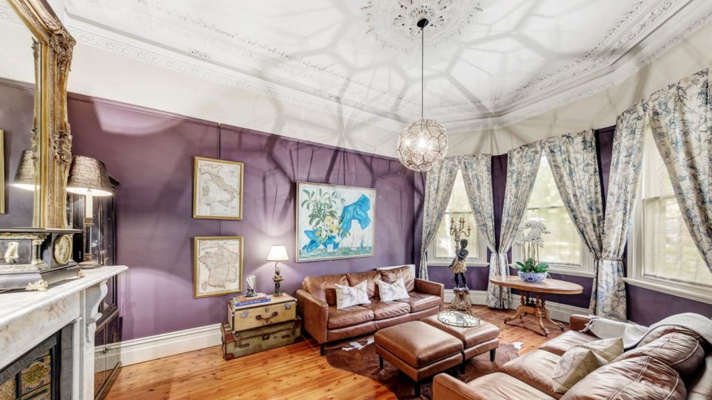 You can't help but gaze up at the intricate ceiling of the front living room. Photo: Jellis Craig
