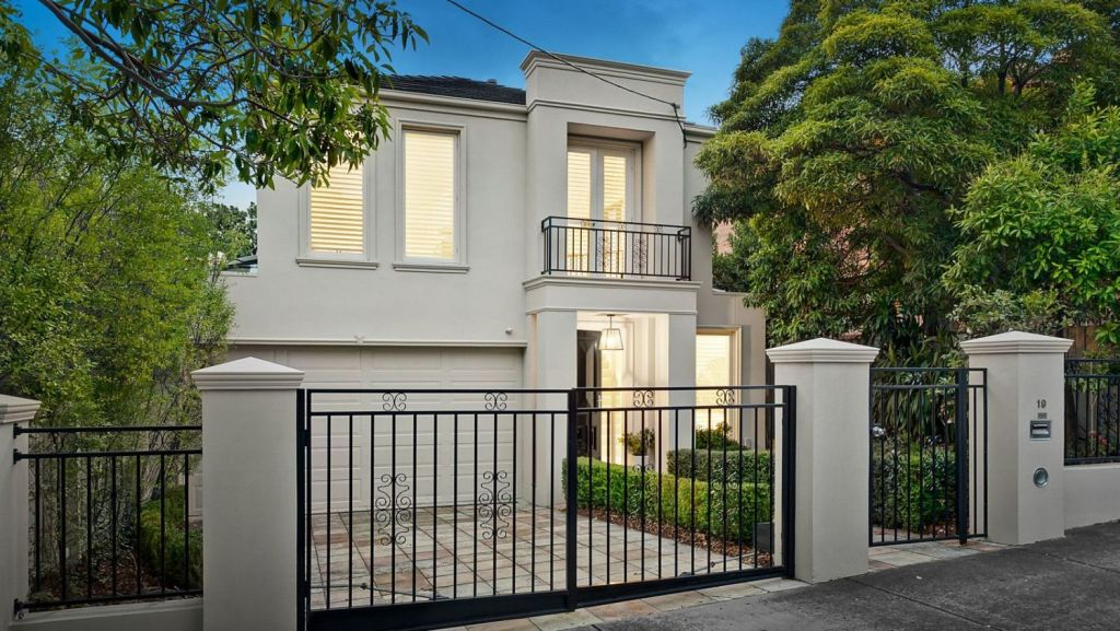 Two families slowly slugged it out for the keys to a contemporary townhouse at 19 Edgecombe Street, Kew. Photo: Jellis Craig