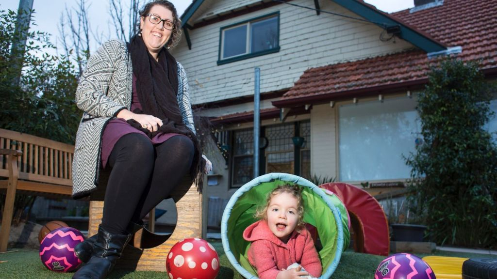 Tarryn Holland, pictured with her two-year-old daughter Odessa Ahern, chose to live close to the community childcare centre in Elwood. Photo: Stephen McKenzie