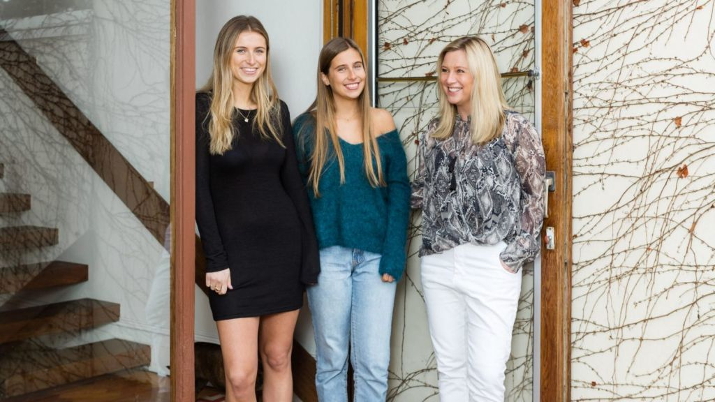 Kate Nicolas, right, with daughters Grace (left) and Eve (centre), has merged two apartments in Armadale into one townhouse. Photo: Greg Briggs