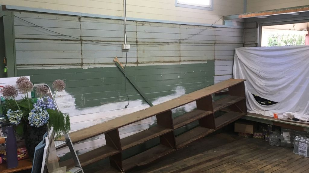 Removing the old shelving and fitting during the renovation process. Photo: Gary Wall