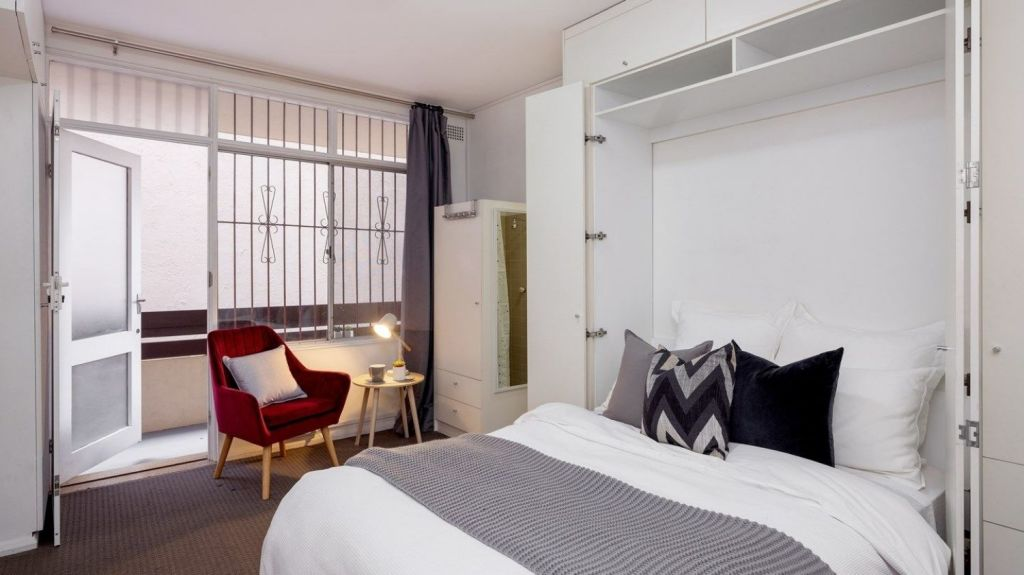 The 26-square-metre apartment at 1/54-58 Johnston Street, Annandale, saves space with a fold-down bed.