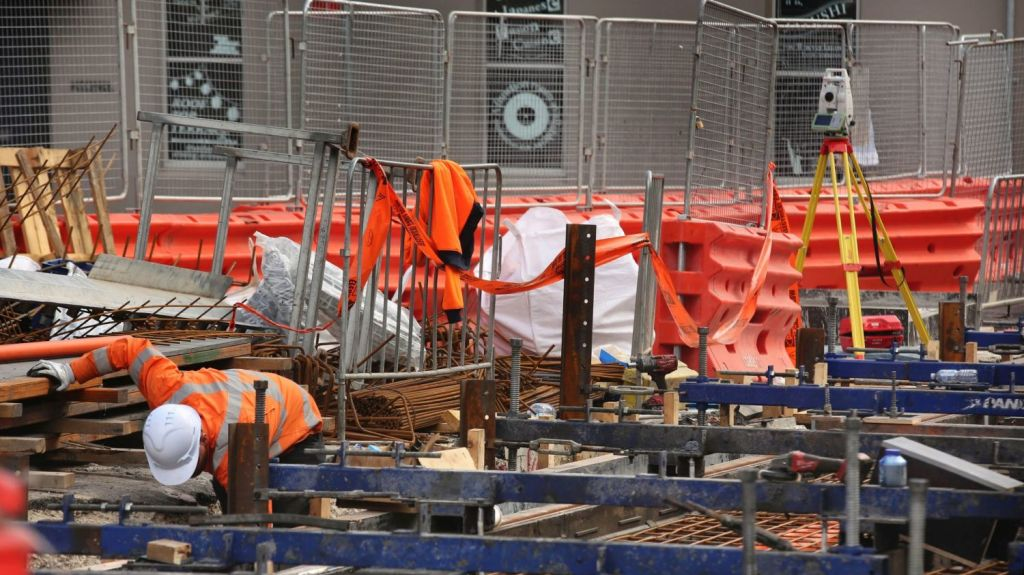 Construction workers and engineers continue with the Sydney Light Rail Project in Devonshire St, Surry Hills. Photo: James Alcock