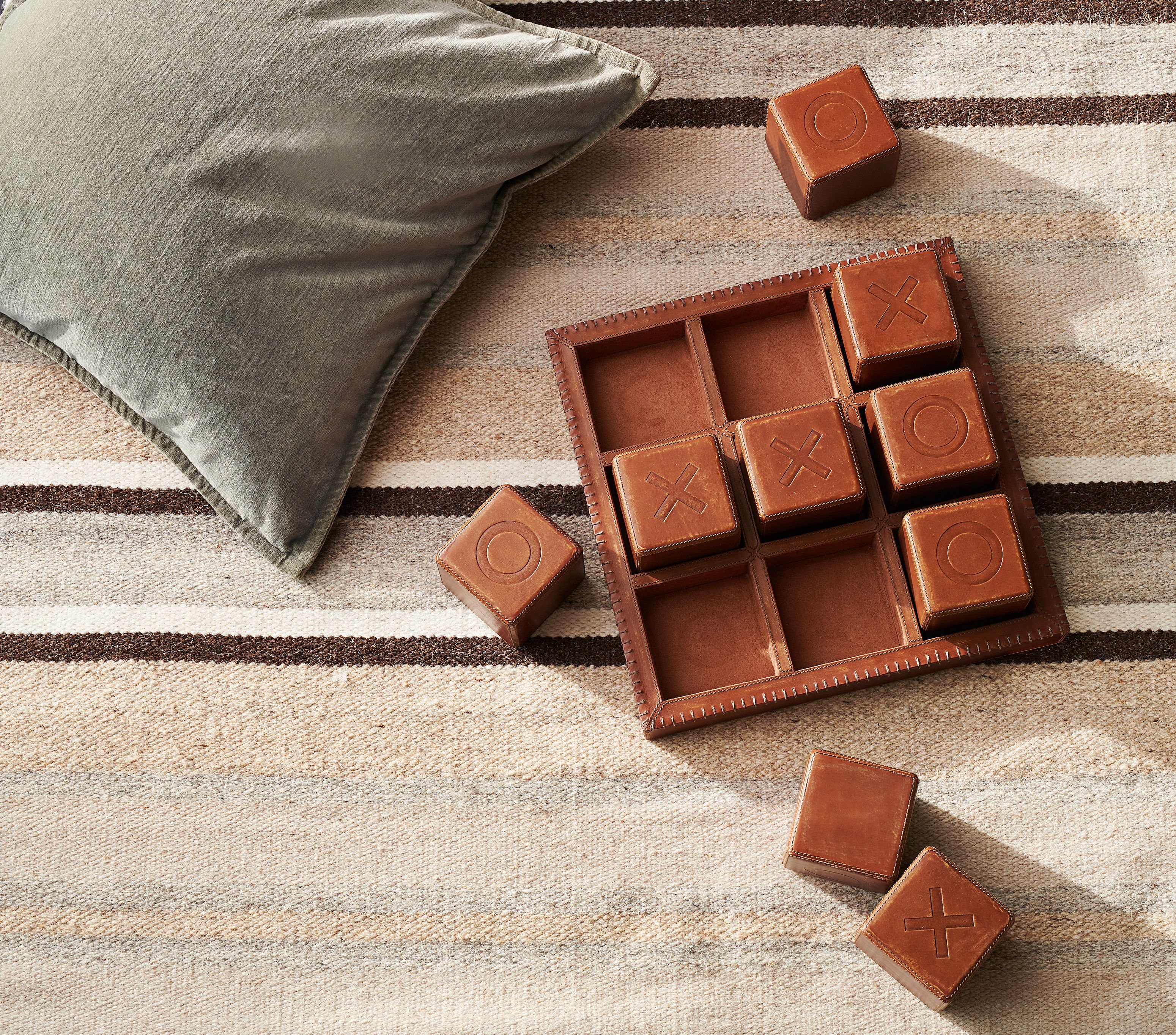 Pottery Barn Naughts and Crosses is oversized, in embossed leather