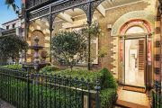 Holiday period bites as East Melbourne terrace passes in $200,000 below price range