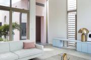 Family visits to Italy form the inspiration behind this pastel-hued home