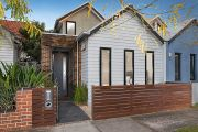 Young couple drops $965,000 for Northcote terrace home at auction