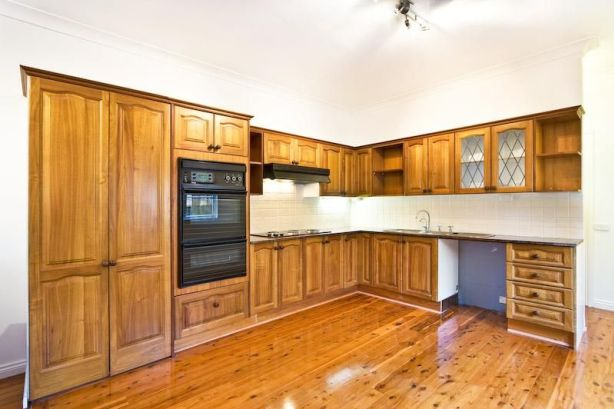 Repainting rather than replacing a dated kitchen might be a better option.
