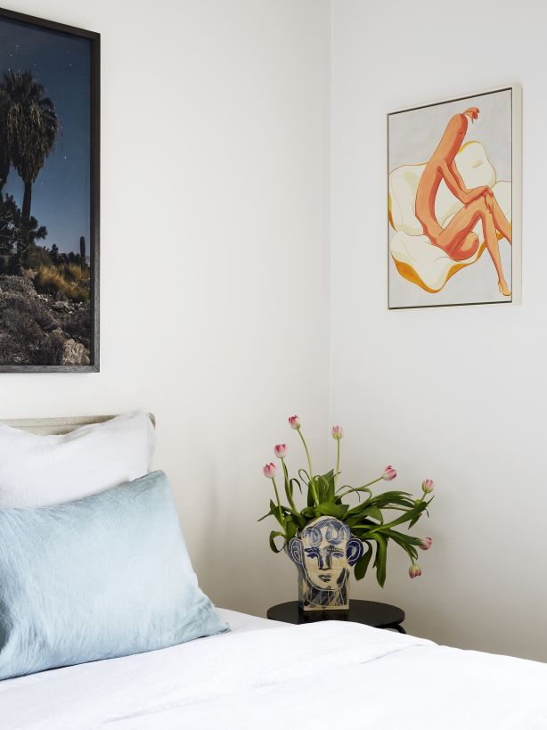 A corner of the bedroom, featuring the couple's favourite John Booth vase and painting by Ivy Haldeman. Photography / Caitlin Mills Styling / Annie Portelli