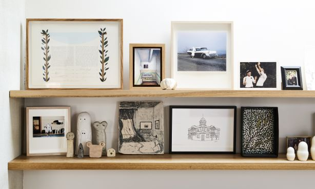 A selection of the couple's favourite things, including their marriage certificate. Photography / Caitlin Mills Styling / Annie Portelli