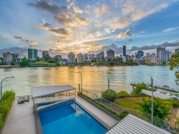 The property features rare uninterrupted access to the Brisbane river.
