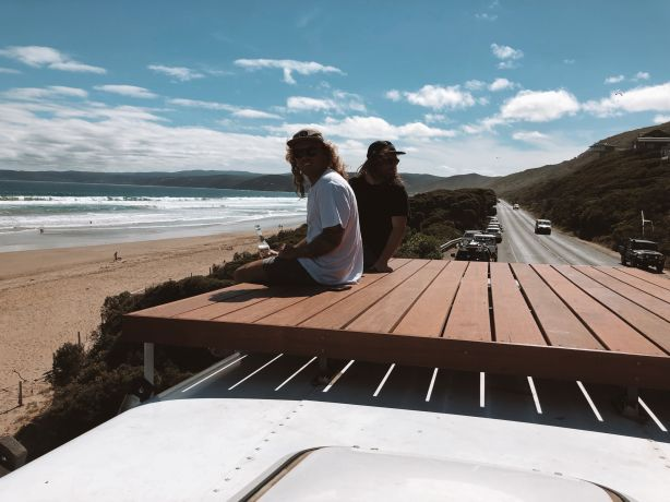 Dean on the roof of his bus with a friend.