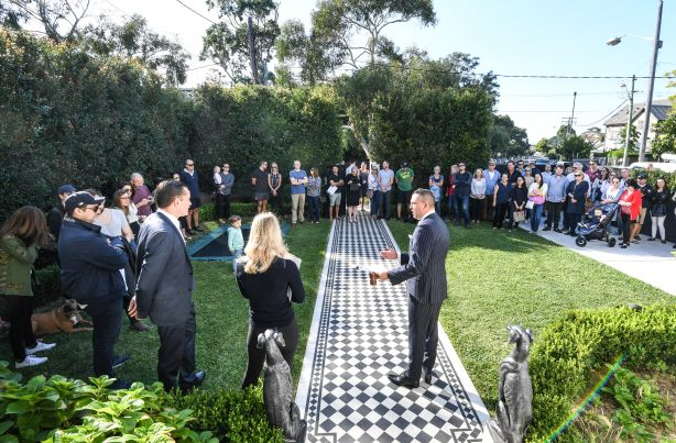 Clarence White with part of the large crowd who turned up for the successful auction of 48 Arden Street Clovelly. Photo by Peter Rae. Saturday 13 April, 2019