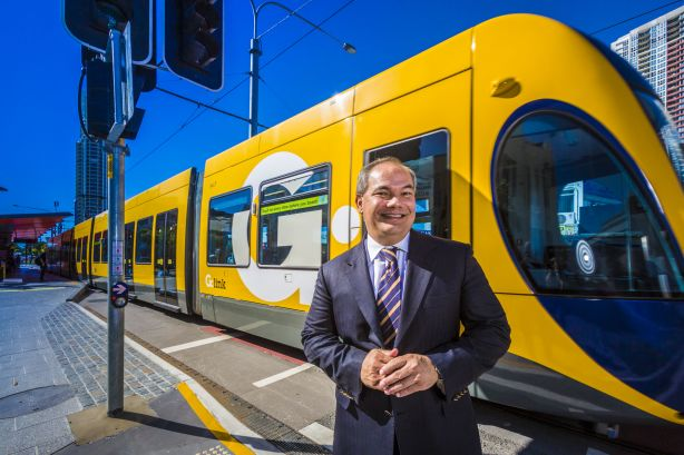 Gold Coast Mayor Tom Tate standing in front of the light rail network at Southport in 2015.
