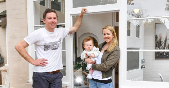Nathan Sparke and Rebecca Chant, with baby Willow, out front of their Cremorne apartment.