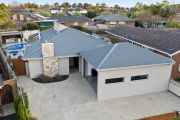 Rowville home sells for $1.517 million at auction after 40 bidders register