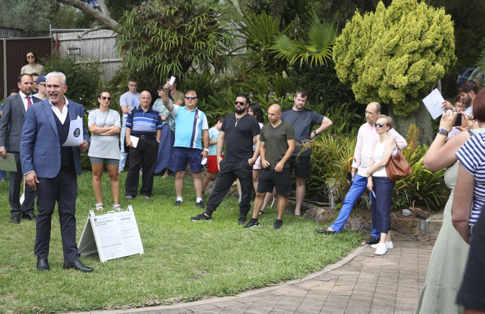 The auction of 7 Finlays Avenue, Earlwood.