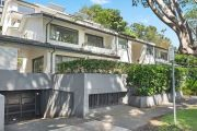 Waterside Sydney apartment smashes auction reserve by $1.1m in hot weekend