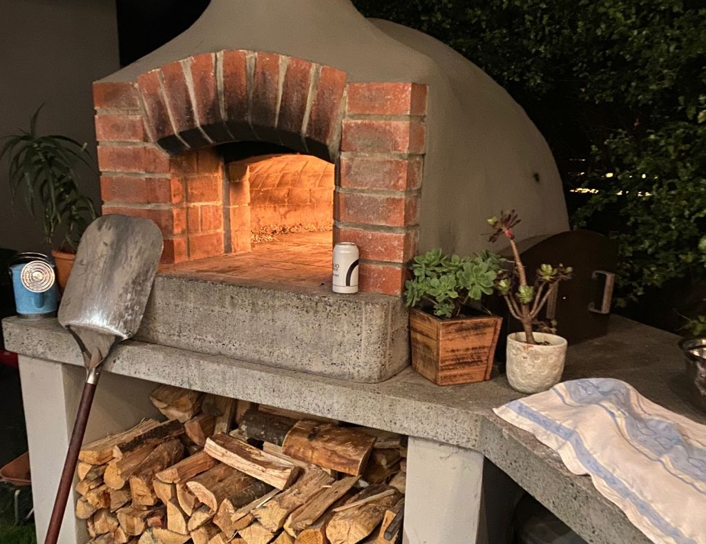 Pizza ovens aren't just for pizzas. Roast chicken and pork crackling are just some of the possibilities.