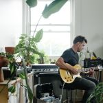 A tiny Melbourne apartment filled to the brim with plants and musical instruments