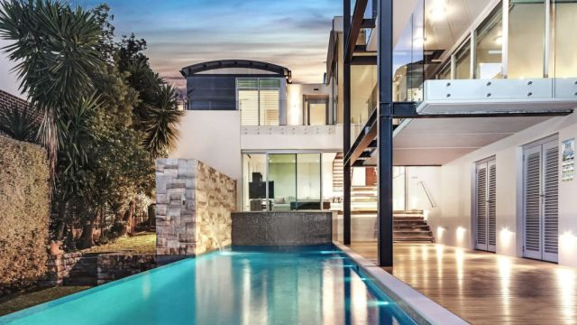Third-time lucky for large home that set suburb record in Sydney's south