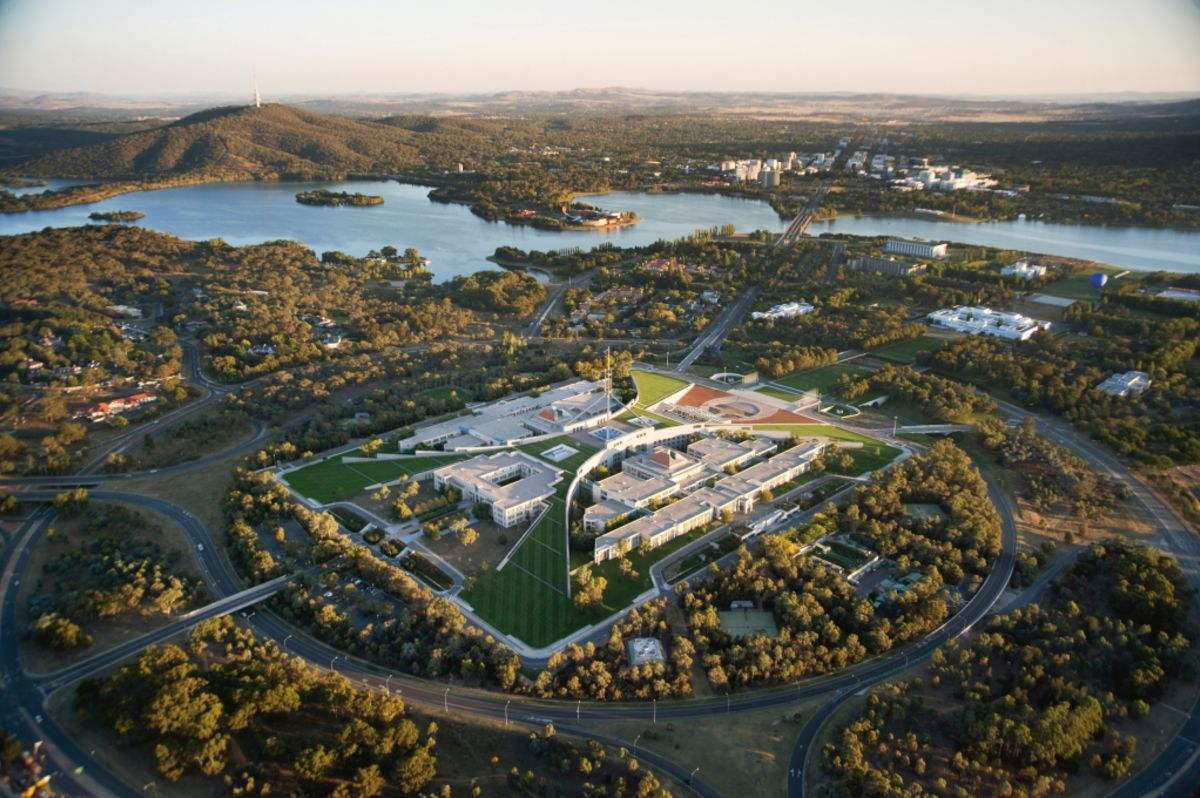 How many politicians own property in Canberra and where?