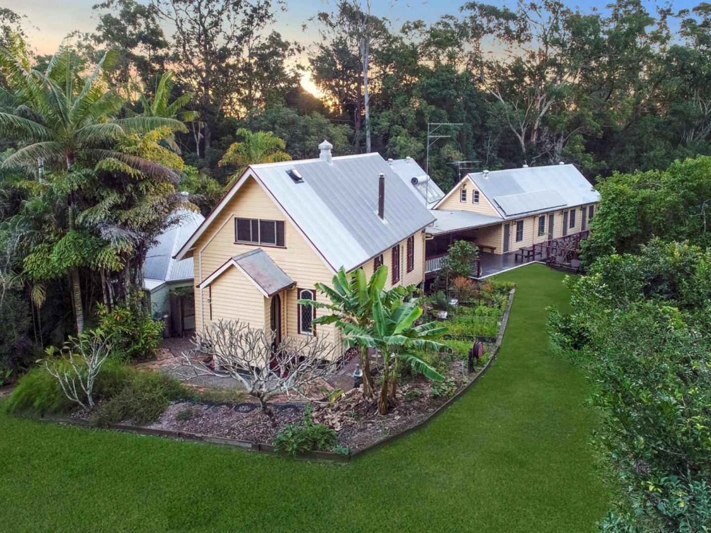 This lovingly restored property in the World Heritage-listed Glass House Mountains, also comes with repurposed train carriages. The seven-bedroom home is at 198 Barrs Road, Glass House Mountains QLD.