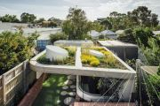 A liveable ode to art: The family home with a garden on the roof