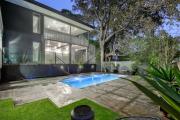 Brisbane's auction clearance rates surge as buyers regain confidence