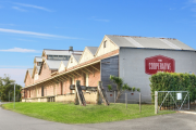 Former dairy co-op site in Gerringong sold to investment banker for $2.25 million