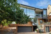 Melbourne auctions: Three bidders push Toorak townhouse to $2 million sale