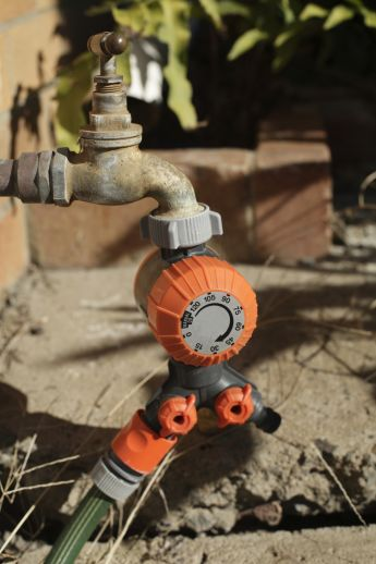 A tap timer is a smart choice when using a lawn sprinkler.
