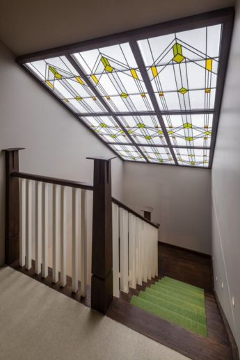 It looks authentically Arts and Crafts, but neither the stairs nor leaded skylight existed until last year.