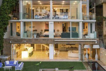 Ex-Woolworths boss in prestige home sale bonanza