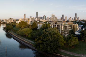 When one riverfront apartment isn't enough: The Brisbane downsizers buying two units and joining them together