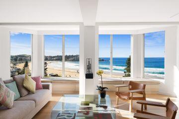 Inside the designer Bondi apartment boasting 18 metres of ocean-front vistas