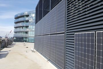 Apartment building fitted with vertical solar panels an 'Australian first'