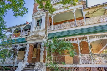 Historic Brisbane house listed for sale against elderly owner's wishes
