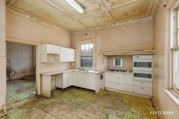 This Melbourne house with a derelict kitchen and bathroom has sold for $7.24m
