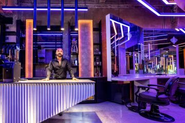 Inside the 'psychedelic' barber shop that feels more like a nightclub