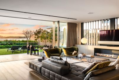 Ex-Ferrari chief smashes suburb record by $2m as he sells beachfront pad