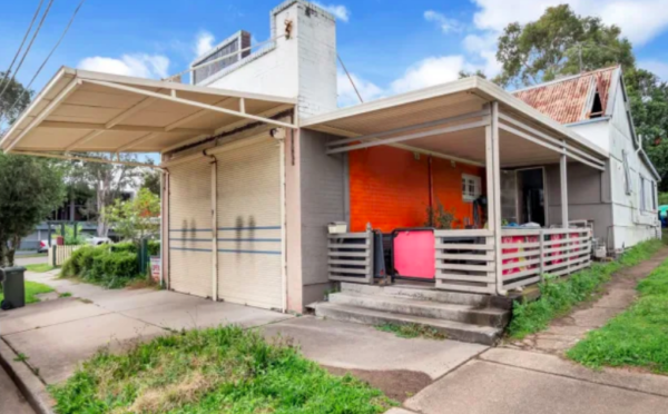 Rundown shop and house sells for three times reserve