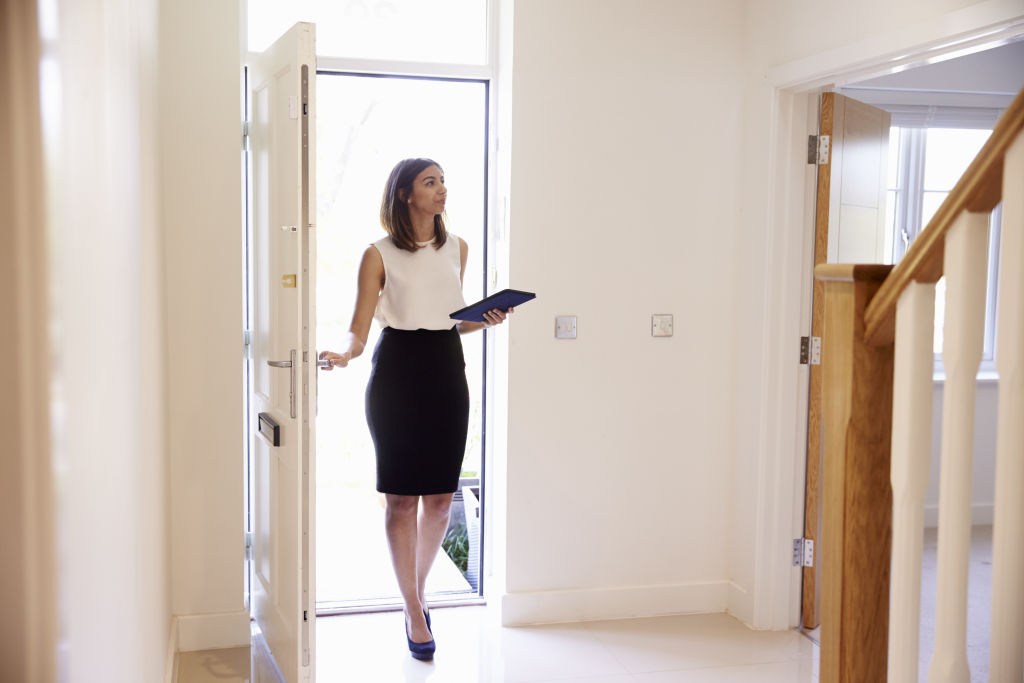 Valuer inspecting a home