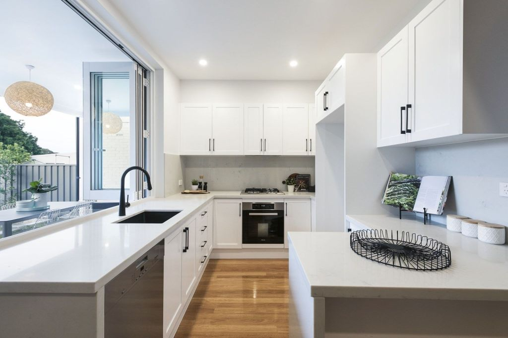 Modern, white kitchen with timber floors