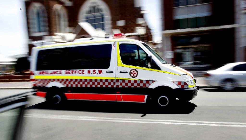 Ambulance driving down street
