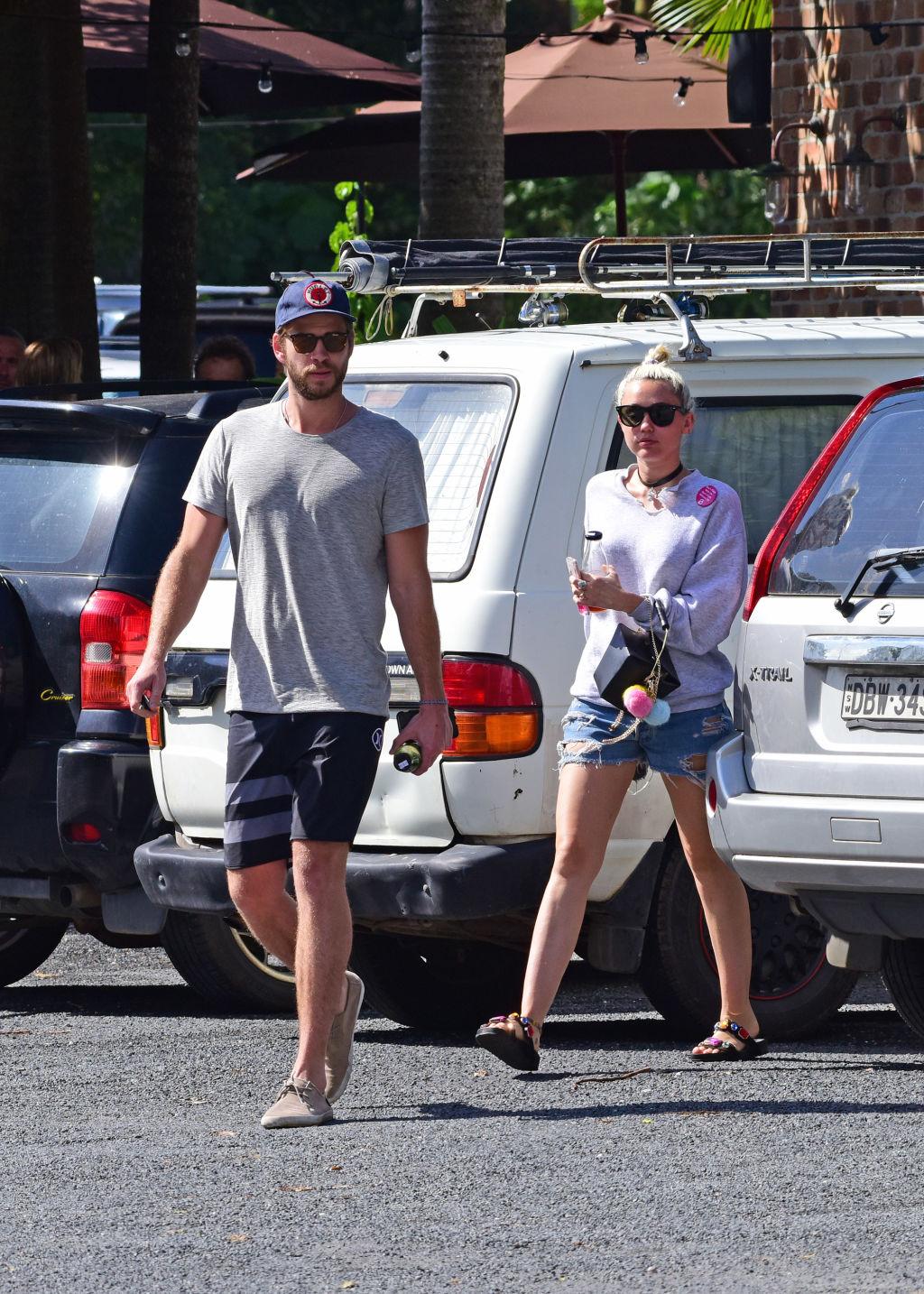 Liam Hemsworth and Miley Cyrus in Byron Bay last weekend. Pic credit: Getty